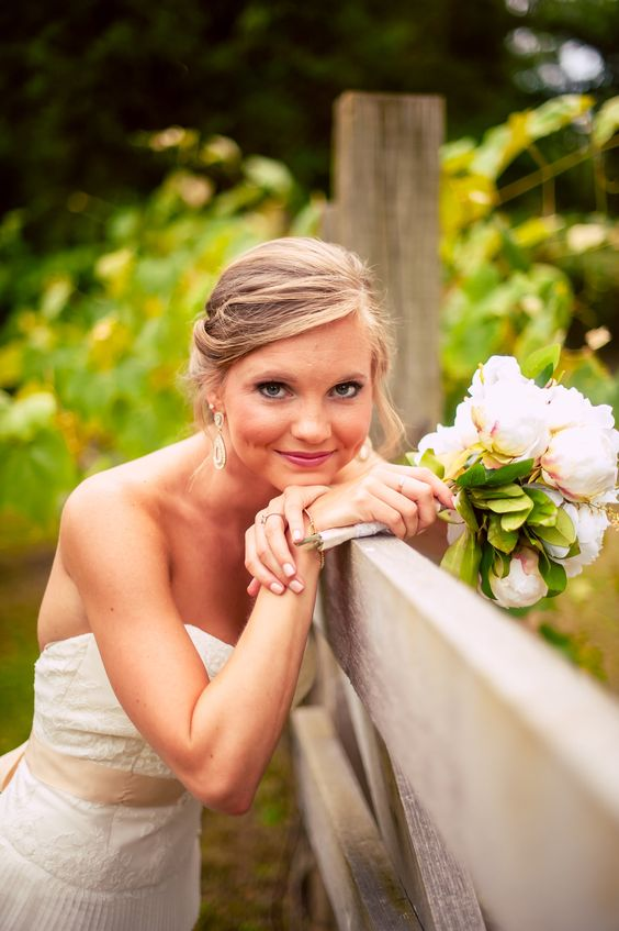 We melt over this bride + her cute, informal pose. With a breathtaking bouquet, stunning dress (from Kelly's Closet), wild flowers, grass, + an old fence this bride looks even MORE ravishing! ::Lindsey + Josh's shabby chic wedding at McDaniel Farm Park in Gwinnett, Georgia:: bridal portrait, wedding attire, wedding photography