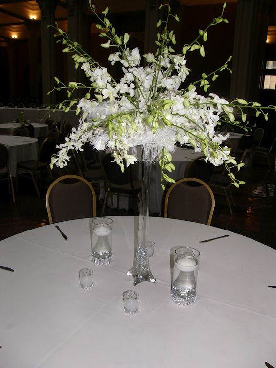 Eiffel Tower Flower Arrangements Wedding Spray Of Dendrobium Orchids And Feathers On An