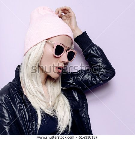 Stylish Blonde in fashionable hat beanie and pink glasses Vanilla vibration Swag