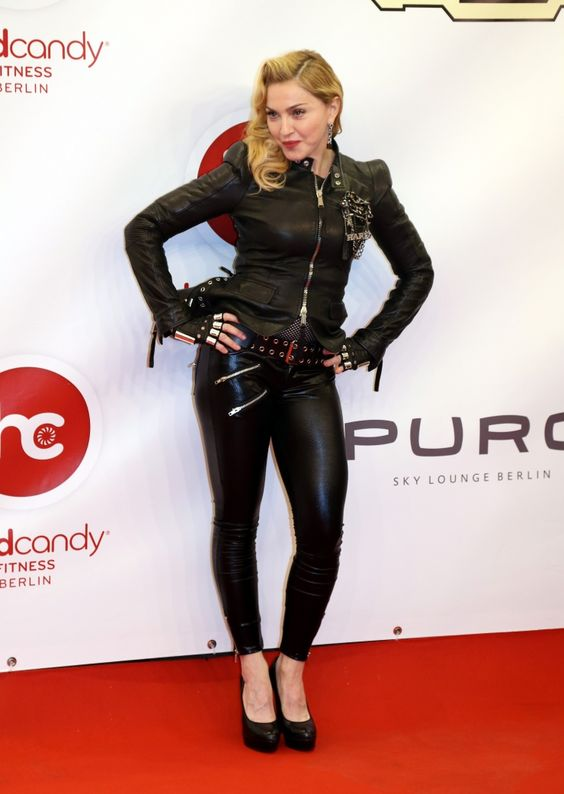 Come on, vogue in leather. Madonna strikes a pose at the opening of her Hard Candy Fitness club on Oct. 17 in Berlin