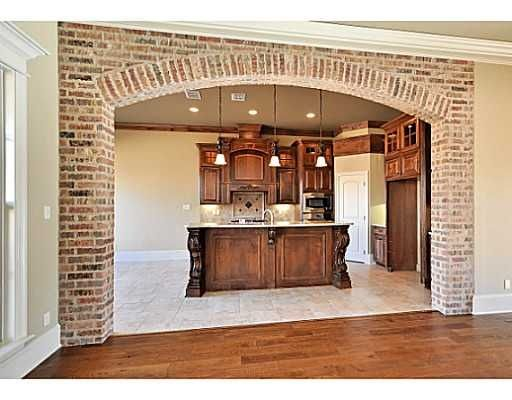 Brick arched opening kitchen pinterest the two for Interior wall arches