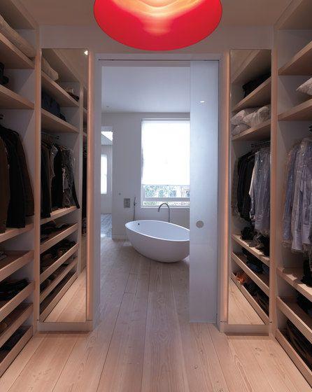 closet space onto gorgeous bathroom with Dinesen floor