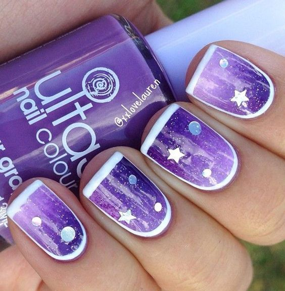 Breathtaking Purple nail art design with embellishments. Make your nails look really astounding with the sandwich style glitter polish design and thin French tips. You can also add star and polka dot shaped sequins in the sandwich to make the design even more interesting.