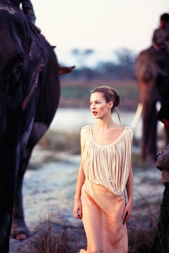 Kate Moss photographed by Arthur Elgort in Nepal for Vogue UK March 1994 ('Simply Divine'). Styled by Lucinda Chambers.