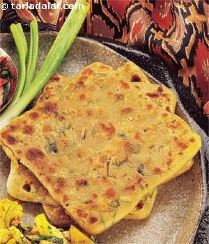 A Sindhi specialty made with whole wheat flour kneaded with onions and coriander to make a filling roti.