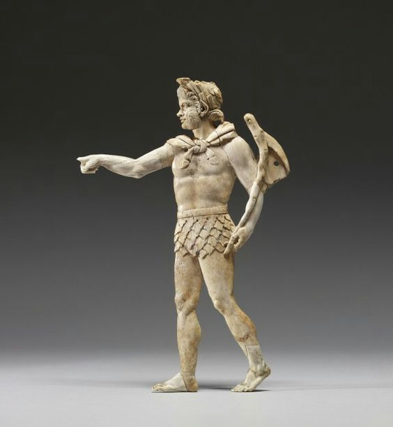 Ivory applique with satyr walking to the left. Greek. 2nd century B.C. | The Walters Art Museum:
