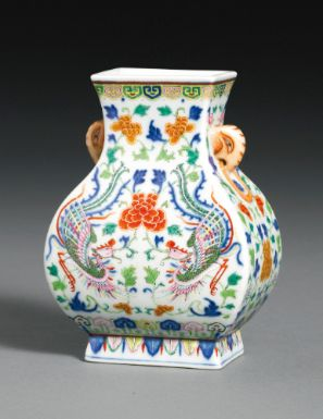 A FINE AND RARE UNDERGLAZE-BLUE POLYCHROME ENAMEL 'PHOENIX' VASE, FANGHU. QIANLONG SEAL MARK AND PERIOD. Of rectangular section, the pear-shaped body rising from a spreading foot to a waisted neck, flanked by a pair of elephant handles. Intricately enamelled to the front and back with a pair of phoenix descending in flight, the sides similarly decorated, the foot skirted with a pendent stiff leaf band, inscribed to the base with a six-character seal mark. 15.4cm., 6 1/8 in.