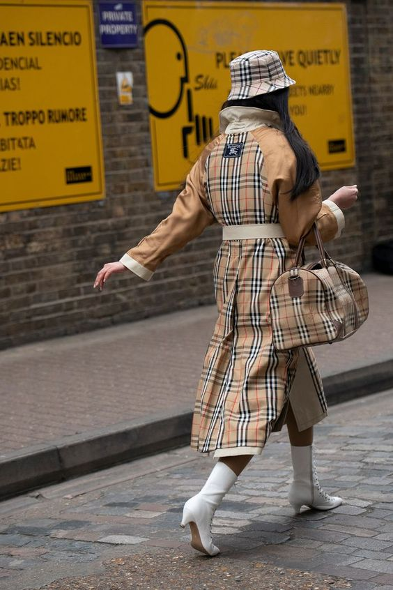 Burberry vintage check: a plaid trench coat, holdall and bucket hat worn together