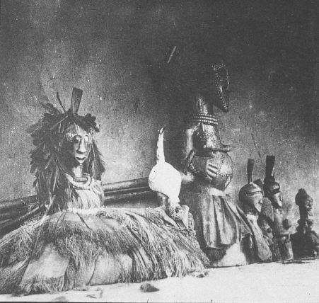 Young Igbo Mask Dancers Wearing Net Songye Carvings