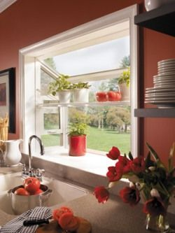 """Mini bay window over the kitchen sink with shelving...a """"kitchen garden"""" for fresh herbs and small veggie pots"""