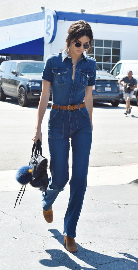 Out and about in Los Angeles, Jenner pays homage to '70s style in a bell-bottmomed denim jumpsuit by FRAME.