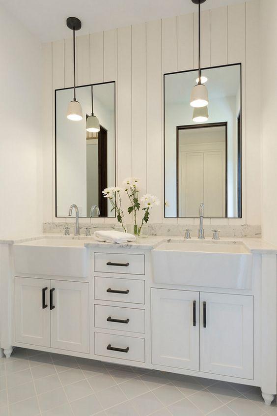 bathroom shiplap wall behind mirrors bathroom with