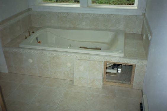 Tub surround tubs and tub tile on pinterest for Whirlpool garden tub