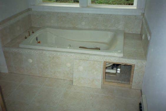 Tub surround tubs and tub tile on pinterest for Whirlpool garden tub