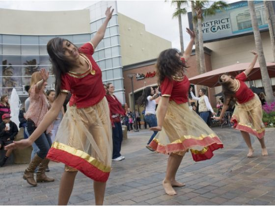 Members of the Mad Bollywood Dance company Circle perform a Bollywood dance as part of a flash mob at the District in Tustin.