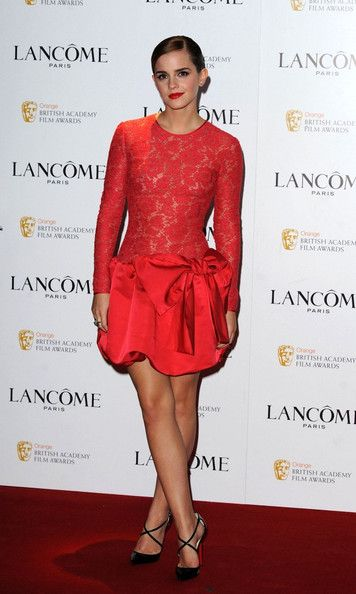 Emma Watson Pumps    Emma accessorized her red lace frock with black patent leather pumps complete with criss-cross straps.  Brand: Christian Louboutin