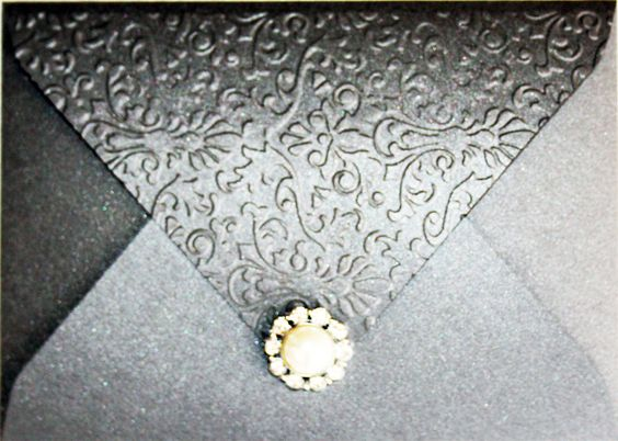 grey metallic euro flap, custom embossed invitation with pearl embellishment, layered card set inside