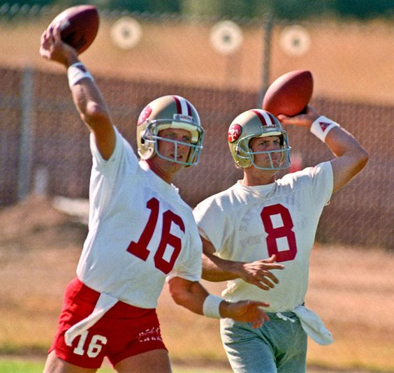 Joe Montana and Steve Young work on their throwing during a 199049ers practice. The duo led San Francisco to five Super Bowl titles in the '80s and '90s. Is this year's 49ers squad ready for a Super Bowl run? After beating Green Bay in Week 1, many NFL experts believe they are. (Al Golub/AP)  KING MMQB:Thoughts on the NFL's opening weekBANKS:RGIII delivers on hype|Week 1 Snap Judgements