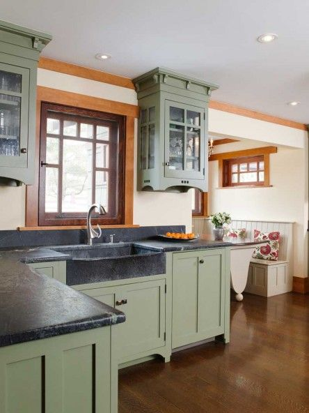 Colorful cabinets really make a kitchen stand out and in this kitchen the ivy green makes the black soapstone look just right. It fades up the wall and down into the sink and you get a really outdoorsy look.