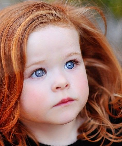 Magnificent hair and eyes! Looks like a little Irish babe.