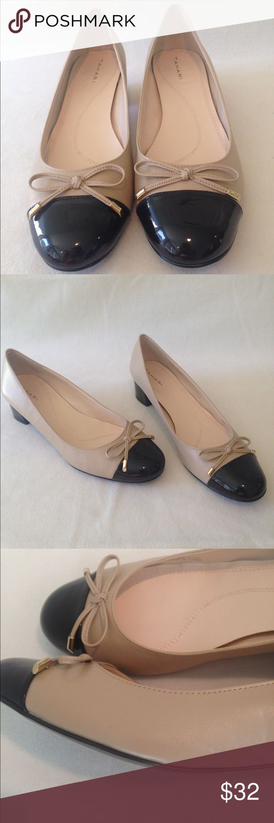 TAHARI Women's heel pumps cap toes patent leather TAHARI 1.5 Inch heel pumps,  leather upper and black patent leather heels. Cap toes. They're perfect for all types of occasions! Condition:Used but they are in good condition. Gently worn; comes from a smoke-free home. Very minimal scuff on soles and outer shoe as shown in pictures.  Style:Pumps Type:cap toes Size:10M Heel Height:1.5 inch Color:beige / tan  Material:leather upper Tahari Shoes Heels