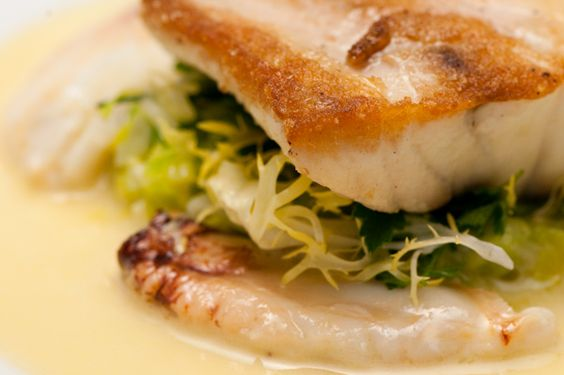 Roasted Striped Bass with Dungeness Crab and Champagne Butter