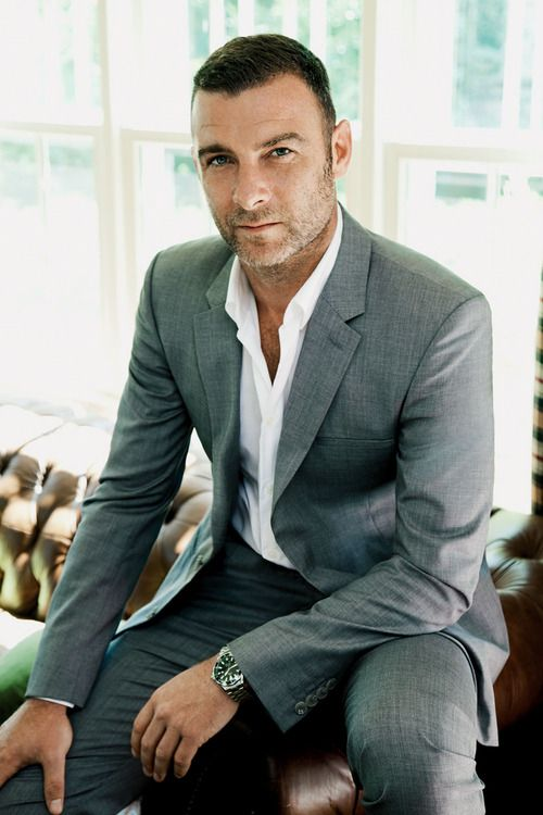 Liev Schreiber, looking great in a tailored grey suit with a