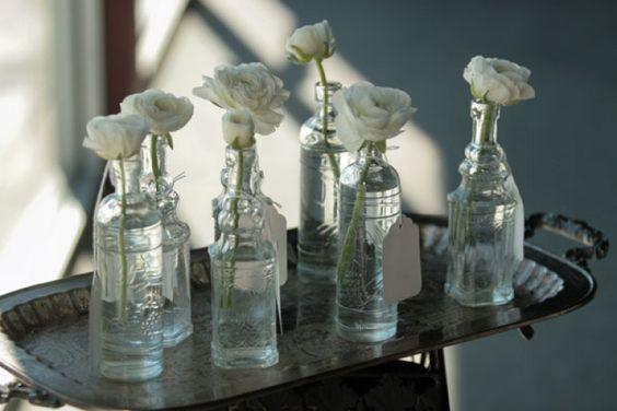 single flowers in bottles/jars