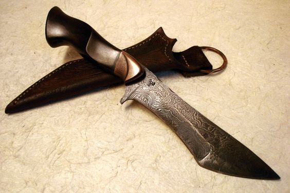 Damascus Recurve Tanto by Kip Kaiser.  Made from high contrast Damascus in a recurve tanto pattern. Beautifully carved and shaped handle. 6.5 inch blade, 12.25 inches overall.