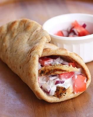 Easy Chicken Gyros (Pita Wrap)    For an easy and fast lunch try to make these yummy chicken gyros. They will fill you with wholesomeness and you won't feel hungry for several hours. The pitas are wrapped with a creamy tzatziki sauce, chicken, tomatoes and red onions. Chicken is to be marinated and cooked, but if you have some leftovers of […]  Continue reading...    The post  Easy Chicken Gyros (Pita Wrap)  appeared first on  All The Food That's Fit To Eat .