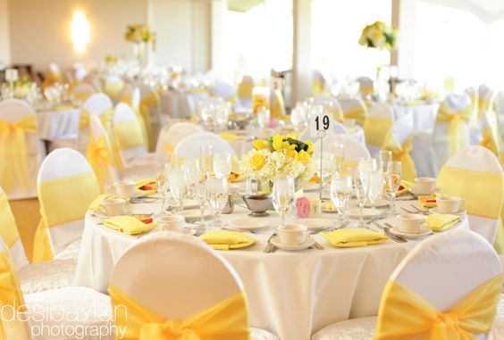 white table clothes  white chair covers  white napkins  yellow chair sashes    check  all
