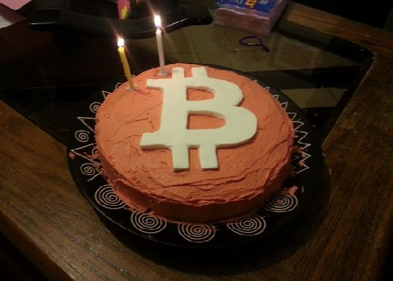 Bitcoin birthday cake with candles blazing. Delicious and profitable