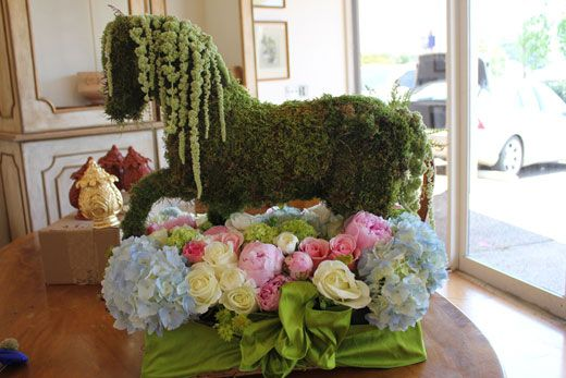 A plastic horse wrapped in moss.  Kentucky Derby party. #derby #party