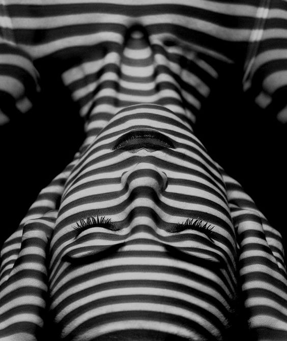 Black and white stripy shadows on a face: