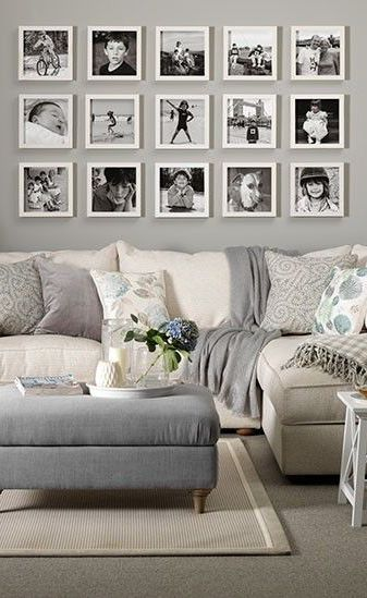 A nice gallery wall display for over the sofa using white frames and black and white photos.: