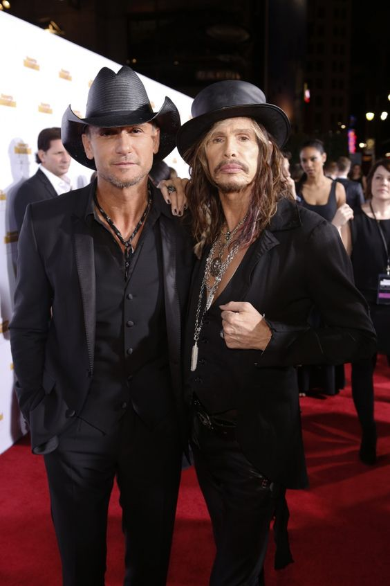 The definition of cool and beautiful. Current GRAMMY nominee Tim McGraw and Steven Tyler arrive at Sports Illustrated Swimsuit's 50 Years Of Beautiful celebration on Jan. 14 in Hollywood, Calif.