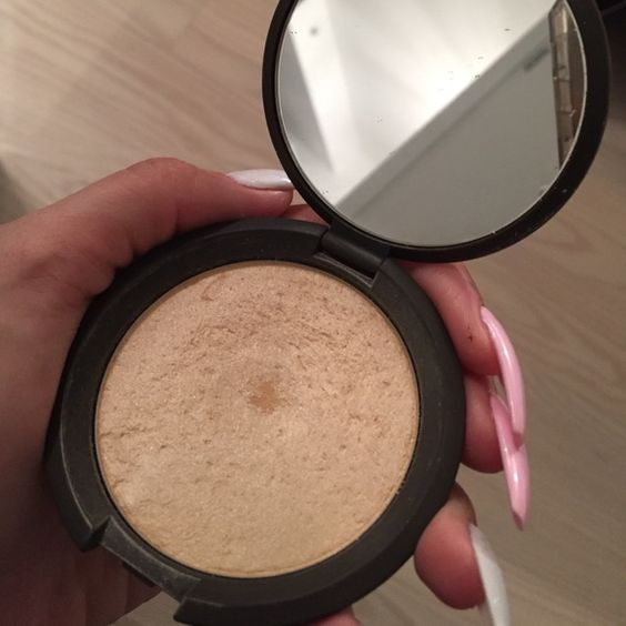 Becca moonstone highlighter Used for a short time.  Otherwise great condition! BECCA Makeup Luminizer