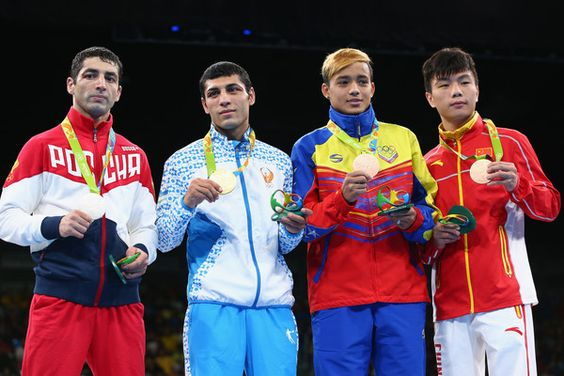 Silver medalist Misha Aloian of Russia, gold medalist Shakhobidin Zoirov of Uzbekistan and bronze medalists Yoel Segundo Finol of Venezuela and Jianguan Hu of China pose on the podium during the medal ceremony for the Men's Boxing Fly (52kg) on Day 16 of the Rio 2016 Olympic Games at Riocentro - Pavilion 6 on August 21, 2016 in Rio de Janeiro, Brazil.