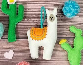 hand-sewn and stuffed pink felt hanging decoration Drama llama