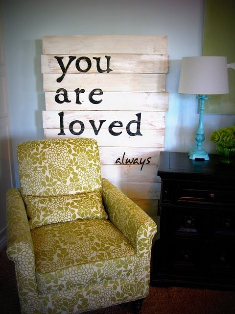 so love this (both the chair and the words on wood) ~ perfect for a sitting room or cozy corner
