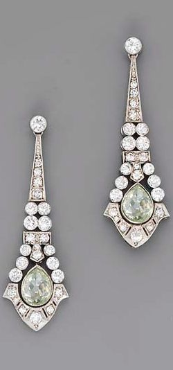 A PAIR OF ART DECO COLOURED DIAMOND AND DIAMOND EAR PENDANTS  Each designed as a central fancy intense yellowish-green diamond weighing 0.74 carat within the circular-cut diamond geometric surround to the graduated diamond line surmount: