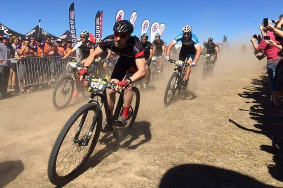 Riders racing in Mont 24 —Australia's biggest mountain biking event — in Kowen Forest (Image: ABC/Ian Cutmore) #bikes #canberra #sport