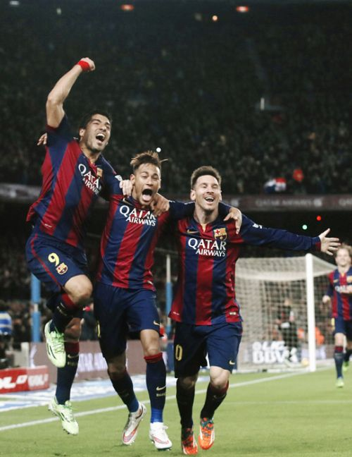 Luis Suarez, Neymar and Lionel Messi celebrate a goal against Atletico Madrid during their Spanish First Division soccer match at Camp Nou stadium in Barcelona January 11, 2015.