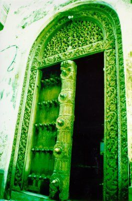 Coming from a family obsessed with the Wizard of OZ, this Emerald City inspired door would be a great addition to our backyard