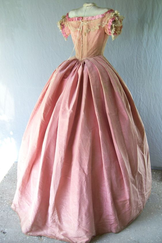 Born in the wrong century? Pink moire ballgown c.1860. Not gonna lie a big part of me wants to wear this to a ball. The kind they would have at Netherfield Park...