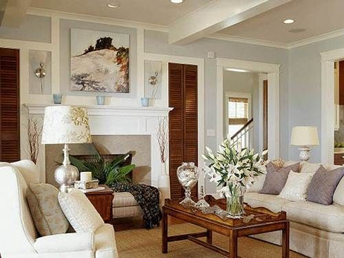 warm living room colors. Stunning living room with gorgeous gray paint color  Sherwin Williams Fawn Brindle framing white built in cabinets stone fireplace Descripti
