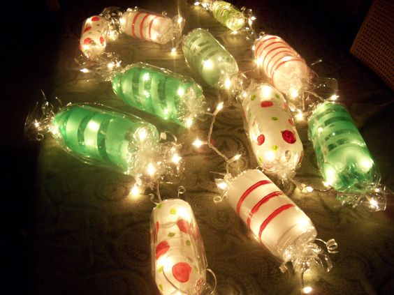 Light up Candy Garland.. Cut ends off soda bottles paint candy stripes wrap in clear cellophane ...