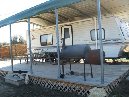 Using A Metal Carport For Camper And Deck For Moms Home
