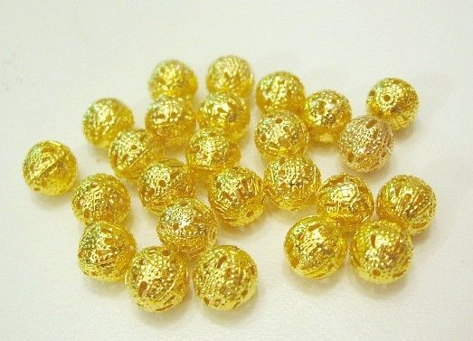 This listing is for 30 round filigree beads. They are gold plated and measure 8mm in diameter. They make great spacers or accents for your jewelry