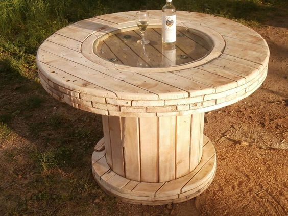 Excellent work recycling this old cable spool into a table for Wire reel furniture